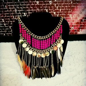 Gold metal chain necklace with fuchsia beads